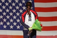 The U.S. flag is raised for gold medallist Brittany Bowe of the U.S. on the podium of the women's 1000 meter race of the speedskating single distance world championships at Thialf ice rink in Heerenveen, Netherlands, Friday, Feb. 13, 2015. (AP Photo/Peter Dejong)