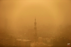 A mosque is seen through the haze of a sandstorm in Cairo, Egypt, Wednesday, Feb. 11, 2015. Egypt's Cairo International Airport briefly closed to arrivals Tuesday as a sandstorm descended over the country that also disrupted traffic at other airfields and seaports, officials said. (AP Photo/Hassan Ammar)