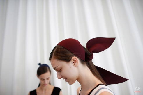 Models Larissa Marchiori, of Brazil, right, and Natt Mitrovic, of Switzerland, wait backstage before the DelPozo Fall 2015 collection show during Fashion Week, Wednesday, Feb. 18, 2015, in New York. (AP Photo/Jason DeCrow)