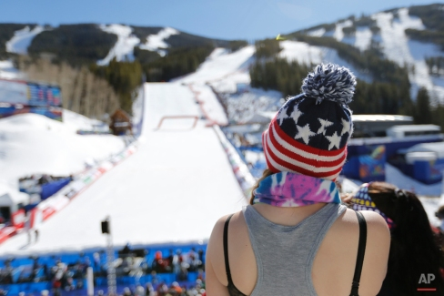 A fan watches during the women's downhill at the alpine skiing world championships on Friday, Feb. 6, 2015, in Beaver Creek, Colo. (AP Photo/Brennan Linsley)