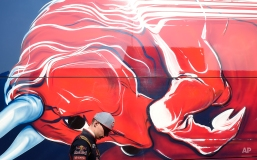 Max Verstappen of Netherlands and Scuderia Toro Rosso walks by the paddock during the 2015 Formula One testing at the Barcelona Catalunya racetrack in Montmelo, Spain, Friday, Feb. 20, 2015. (AP Photo/Manu Fernandez)