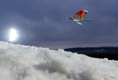 An unidentified athlete soars through the air during the trial jump the mens' Large Hill Individual competition at the Nordic Skiing World Championships in Falun, Sweden, Thursday, Feb. 26, 2015. (AP Photo/Matthias Schrader)
