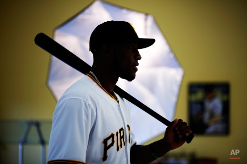 Pittsburgh Pirates' Starling Marte poses in front of a photographer's umbrella during photo day before a baseball spring training workout in Bradenton, Fla., Thursday, Feb. 26, 2015. (AP Photo/Gene J. Puskar)
