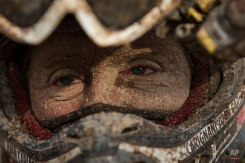 Yamaha quad rider Juan Carlos Carignani, from Italy, arrives with his face covered in dirt at the Uyuni camp after completing the seventh stage of the Dakar Rally 2015 between Iquique, Chile, and Uyuni, Bolivia, Sunday, Jan. 11, 2015. (AP Photo/Felipe Dana)