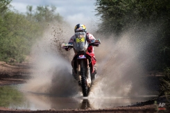 Honda rider Helder Rodrigues of Portugal races during the eleventh stage of the Dakar Rally 2015 between the cities of Termas de Rio Hondo and Rosario, Argentina, Friday, Jan. 16, 2015. (AP Photo/Felipe Dana)