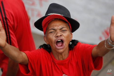 A demonstrator shouts slogans against Sao Paulo's Governor Geraldo Alckmin during a protest against the rationing of water in Sao Paulo, Brazil, Thursday, Feb. 26, 2015. Southeastern Brazil is suffering the worst drought in more than eight decades, and authorities said that water rationing may begin the first week of March. (AP Photo/Andre Penner)