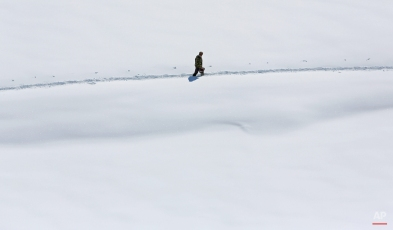 An Afghan villager walks along in snow near to an avalanche in the Paryan district of Panjshir province, north of Kabul, Afghanistan, Friday, Feb. 27, 2015. The death toll from severe weather that caused avalanches and flooding across much of Afghanistan has jumped to more than 200 people, and the number is expected to climb with cold weather and difficult conditions hampering rescue efforts, relief workers and U.N. officials said Friday. (AP Photo/Rahmat Gul)