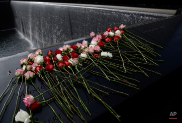 Flowers cover the names of the victims of the 1993 World Trade Center bombing after a ceremony to commemorate its anniversary at the Sept. 11 Memorial in New York, Thursday, Feb. 26, 2015. Officials at the Sept. 11 museum and victims' friends and family marked the 22nd anniversary of the 1993 World Trade Center bombing that killed six people and injured more than 1,000. (AP Photo/Seth Wenig)