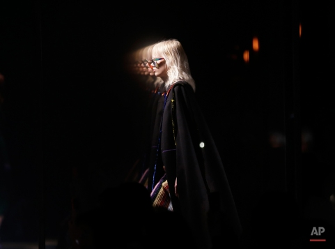 A model wears a creation for Marco De Vincenzo women's Fall-Winter 2015-2016 collection, part of the Milan Fashion Week, unveiled in Milan, Italy, Friday, Feb. 27, 2015. (AP Photo/Antonio Calanni)