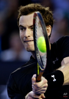 Andy Murray of Britain makes a backhand return to Nick Kyrgios of Australia during their quarterfinal match at the Australian Open tennis championship in Melbourne, Australia, Tuesday, Jan. 27, 2015. (AP Photo/Lee Jin-man)