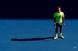 Roger Federer of Switzerland looks up as he plays Andreas Seppi of Italy during their third round match at the Australian Open tennis championship in Melbourne, Australia, Friday, Jan. 23, 2015. (AP Photo/Andy Brownbill)