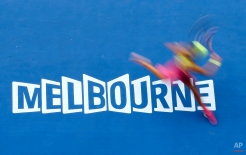 Eugenie Bouchard of Canada plays a shot to Irina-Camelia Begu of Romania during their fourth round match at the Australian Open tennis championship in Melbourne, Australia, Sunday, Jan. 25, 2015. (AP Photo/Lee Jin-man)