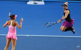Bethanie Mattek-Sands of the U.S., right, and Lucie Safarova of the Czech Republic celebrate after defeating Taiwan's Chan Yung-jan and China's Zheng Jie in their women's doubles final at the Australian Open tennis championship in Melbourne, Australia, Friday, Jan. 30, 2015. (AP Photo/Rob Griffith)