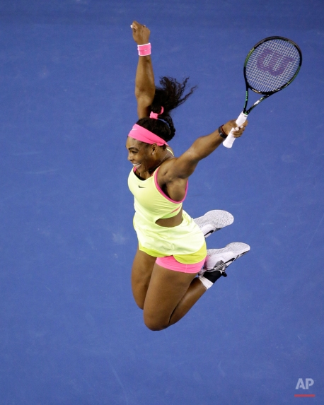Serena Williams of the U.S. celebrates after defeating Maria Sharapova of Russia in their women's singles final at the Australian Open tennis championship in Melbourne, Australia, Saturday, Jan. 31, 2015. (AP Photo/Lee Jin-man)