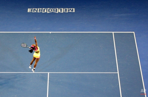Serena Williams of the U.S. celebrates after defeating Maria Sharapova of Russia in the women's singles final at the Australian Open tennis championship in Melbourne, Australia, Saturday, Jan. 31, 2015. (AP Photo/Rob Griffith)