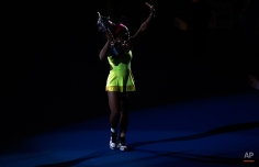 Serena Williams of the U.S. waves to the crowd after defeating Maria Sharapova of Russia in the women's singles final at the Australian Open tennis championship in Melbourne, Australia, Saturday, Jan. 31, 2015. (AP Photo/Andy Brownbill)