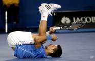 Novak Djokovic of Serbia falls to the court as he plays Andy Murray of Britain during the men's singles final at the Australian Open tennis championship in Melbourne, Australia, Sunday, Feb. 1, 2015. (AP Photo/Bernat Armangue)