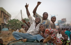Supporters of opposition candidate Muhammadu Buhari riding on top of a car celebrate an anticipated win for their candidate, in Kano, Nigeria Tuesday, March 31, 2015. Nigeria's aviation minister says President Goodluck Jonathan has called challenger Muhammadu Buhari to concede and congratulate him on his electoral victory, paving the way for a peaceful transfer of power in Africa's richest and most populous nation. (AP Photo/Ben Curtis)