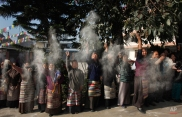 Elderly Tibetan women throw barley flour in the air during an event to mark the 56th anniversary of the failed uprising in the Tibetan capital Lhasa in 1959, in Kathmandu, Nepal, Tuesday, March 10, 2015. The uprising of the Tibetan people against the Chinese rule was quelled by Chinese army forcing the spiritual leader the Dalai Lama and hundreds of Tibetans to come into exile. (AP Photo/Niranjan Shrestha)