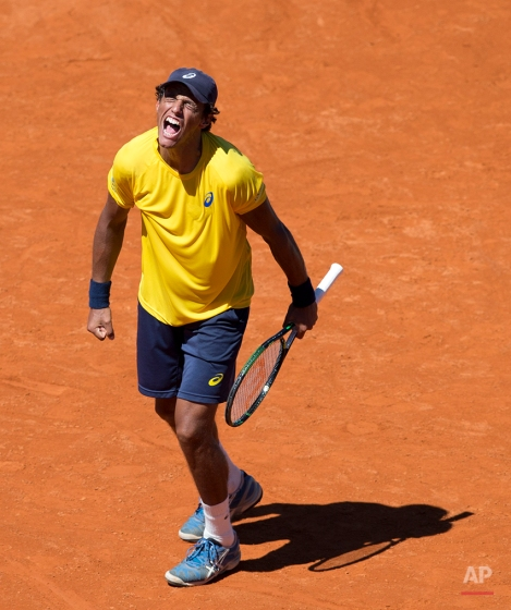 Brazil's Joao Souza reacts during his Davis Cup singles tennis match against Argentina's Leonardo Mayer in Buenos Aires, Argentina, Sunday, March 8, 2015. Souza lost the match to Mayer, after both played the longest Davis Cup singles match ever, at 6 hours, 42 minutes. (AP Photo/Natacha Pisarenko)