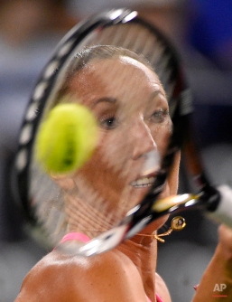 Jelena Jankovic, of Serbia, returns a volley from Sabine Lisicki, of Germany, during their match at the BNP Paribas Open tennis tournament, Friday, March 20, 2015 in Indian Wells, Calif. (AP Photo/Mark J. Terrill)