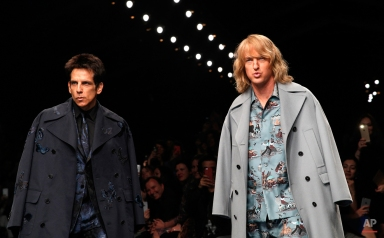 Actors Ben Stiller, left, and Owen Wilson wear creations for Valentino's fall-winter 2015-2016 ready to wear fashion collection, presented at Paris fashion week, Paris, France, Tuesday, March 10, 2015. (AP Photo/Christophe Ena)
