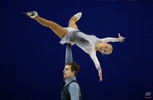 Maria Paliakova and Nikita Bochkov, of Belarus, perform during the Pairs Short Program in the ISU World Figure Skating Championship 2015 held at the Oriental Sports Center in Shanghai, China, Wednesday, March 25, 2015. (AP Photo/Ng Han Guan)
