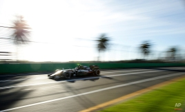 Force India driver Sergio Perez, of Mexico, steers his car during the second practice session for the Australian Formula One Grand Prix at Albert Park in Melbourne, Australia, Friday, March 13, 2015. (AP Photo/Rob Griffith)
