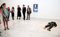 """Kate, the Duchess of Cambridge, left, looks at """"Self Portrait as a Drowned Man"""" by Jeremy Millar, during her visit to the Turner Contemporary in Margate, Kent, Wednesday, March 11, 2015. (AP Photo/Suzanne Plunkett, Pool)"""