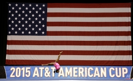 Simone Biles warms up before the American Cup gymnastics competition, Saturday, March 7, 2015, in Arlington, Texas. (AP Photo/LM Otero)