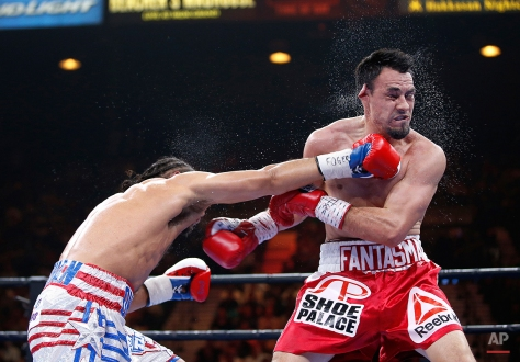 Keith Thurman connects with a right to Robert Guerrero during their boxing match, Saturday, March 7, 2015, in Las Vegas. Thurman won by unanimous decision. (AP Photo/Eric Jamison)