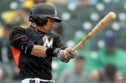Miami Marlins' Ichiro Suzuki swings in a steady rain during the fourth inning of an exhibition spring training baseball game against the New York Mets Saturday, March 7, 2015, in Jupiter, Fla. (AP Photo/Jeff Roberson)