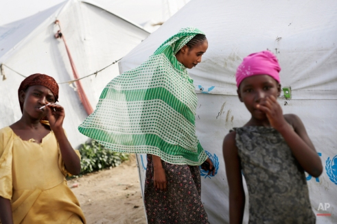 A veiled woman walks through the Zafaye refugee camp, some 15 kms (10 miles) from downtown N'djamena, Chad, Wednesday, March 11, 2015. Over 5000 refugees of Chadian descent who fled the fighting in Central African Republic have been living in the camp for over a year. Chad is also hosting thousands of refugees fleeing the current Boko Haram fighting in Nigeria. (AP Photo/Jerome Delay)