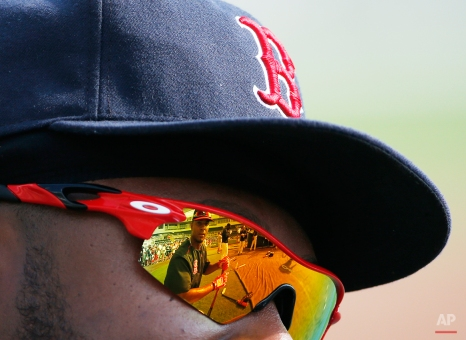 Boston Red Sox's Xander Bogaerts is reflected in teammate Hanley Ramirez's sunglasses before an exhibition spring training baseball game against the Minnesota Twins, Wednesday, March 18, 2015, in Fort Myers, Fla. (AP Photo/Brynn Anderson)