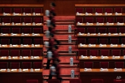 Hostesses prepare tea for members of the National Committee of the Chinese People's Political Consultative Conference (CPPCC) ahead of the closing ceremony of the CPPCC at the Great Hall of the People in Beijing, Friday, March 13, 2015. (AP Photo/Andy Wong)