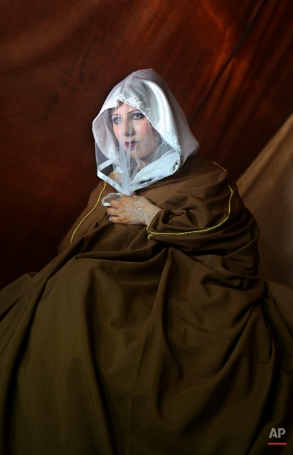 Palestinian bride Kholood Al Zaaneen sits inside a tent built after her family's house was destroyed during Israel's latest military offensive in Gaza, during her wedding ceremony in Beit Hanoun, northern Gaza Strip, in this July 22, 2009 photo. (AP Photo/Adel Hana)