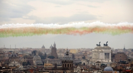 Smoke trails in the colors of the Italian national flag are released by The 'Frecce Tricolori' Italian Air Force acrobatic squad as they flew over Rome, Tuesday, March 17, 2015 to mark the 154th anniversary of the Italian Unification in 1861. (AP Photo/Gregorio Borgia)