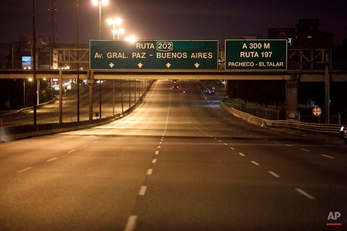 A few cars drive on the Pan-American highway during a transportation strike in Buenos Aires, Argentina, Tuesday, March 31, 2015. (AP Photo/Victor R. Caivano)