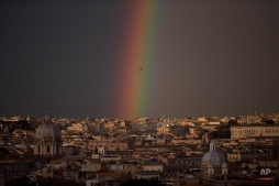 A rainbow forms over downtown Rome, Friday, March 27, 2015. (AP Photo/Alessandra Tarantino)
