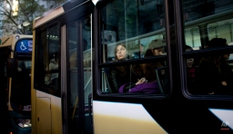 A woman looks through the bus window as she commutes in Buenos Aires, Argentina, Wednesday, Sept. 17, 2014. (AP Photo/Natacha Pisarenko)