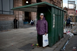 A man stands in front of the Constitucion train station during a transportation strike in Buenos Aires, Argentina, Tuesday, March 31, 2015. (AP Photo/Natacha Pisarenko)