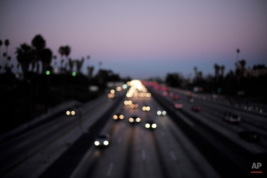 Traffic moves along the 10 freeway on Aug. 26, 2014, in Los Angeles. The I-10 freeway in Los Angeles County is among the most congested freeways in the state according to a report released by the California Department of Transportation. (AP Photo/Jae C. Hong)