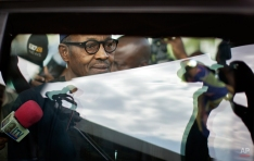 """Nigerian opposition candidate Gen. Muhammadu Buhari is photographed as he walks to his vehicle after signing a joint renewal with President Goodluck Jonathan of their pledge to hold peaceful """"free, fair, and credible"""" elections, at a hotel in the capital Abuja, Nigeria, Thursday, March 26, 2015. Nigerians are due to go to the polls to vote in presidential elections on Saturday. (AP Photo/Ben Curtis)"""