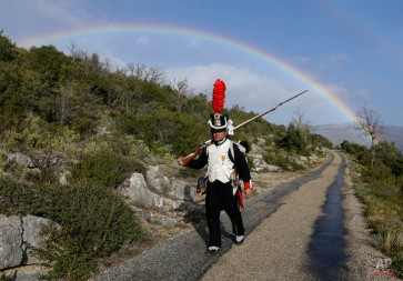 A soldier of French Emperor Napoleon, performed by Emilio, walks in Escragnol southeastern France, as they head for Grenoble, French Alps, in the footsteps of the Emperor Napoleon, during a reenactment, Monday, March 2, 2015. This commemoration celebrates the bicentenary of the Emperor's return after his exile on the island of Elba in 1815. They use the historic road ìroute Napoleonî to go to Grenoble where they will establish their bivouac in municipalities where Napoleon stopped. (AP Photo/Lionel Cironneau)