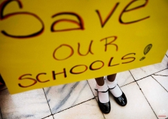 """The shoes of Browns Mill Elementary School fourth-grader Sydney Robinson peek out from under a sign she holds during a rally against Georgia Gov. Nathan Deal's proposal to take over schools dubbed """"chronically failing"""" at the Capitol, Monday, March 23, 2015, in Atlanta. A key House committee is expected to vote on Gov. Deal's proposal Monday afternoon. The Senate already has passed the constitutional amendment and accompanying legislation but the Republican governor could face a tougher fight in the House. (AP Photo/David Goldman)"""