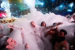 Spring Breakers are covered in foam at The City nightclub in the Caribbean resort city of Cancun, Mexico, early Monday, March 16, 2015. Cancun continues to be one of the top foreign destinations for U.S. college students to spend Spring Break. (AP Photo/Israel Leal)