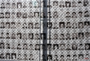 Photographs of Serbs missing and killed during the 1998-99 war in Kosovo are seen in front of Serbia's war crimes court in Belgrade, Serbia, Tuesday, March 17, 2015. Tuesday marks the 11th anniversary of an attack on minority Serbs by Kosovo extremists that sent thousands fleeing their homes. (AP Photo/Darko Vojinovic)