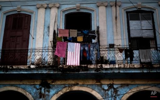 An American flag beach towel hangs on a makeshift clothesline, on a balcony in Havana, Cuba, Sunday, Feb. 22, 2015. (AP Photo/Ramon Espinosa)