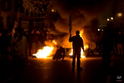 A burning barricade blocks the Pan-American highway during a transportation strike in Buenos Aires, Argentina, Tuesday, March 31, 2015. (AP Photo/Victor R. Caivano)