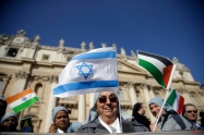 A nun waves Israeli and Palestinian flags prior to the start of Pope Francis' weekly general audience in St. Peter's Square, at the Vatican, Wednesday, March 18, 2015. (AP Photo/Gregorio Borgia)